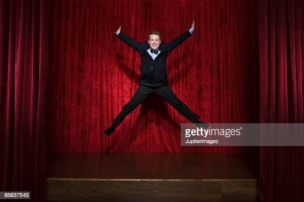 man jumping on stage - vaudeville stock pictures, royalty-free photos & images
