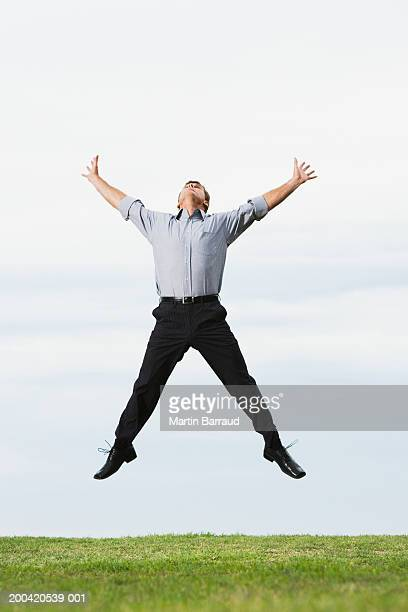 man jumping outstretched - legs apart stock pictures, royalty-free photos & images
