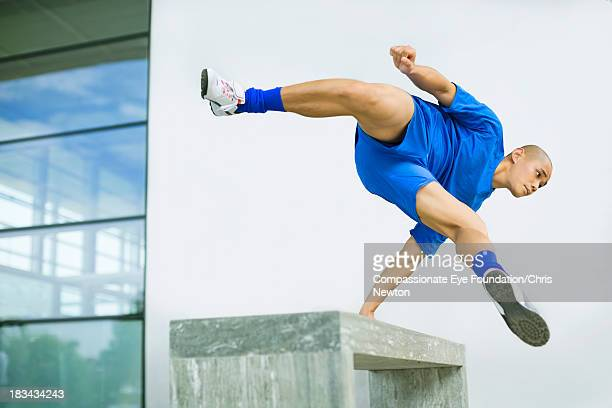 man jumping over bench outdoors - cef do not delete stock pictures, royalty-free photos & images