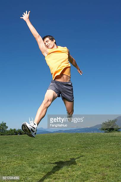 man jumping - forward athlete stock pictures, royalty-free photos & images