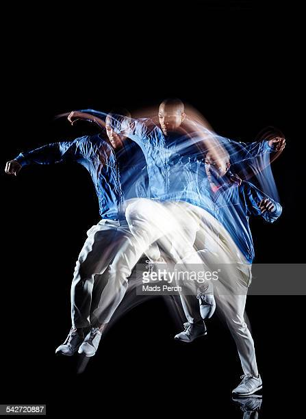 man jumping - long exposure stock pictures, royalty-free photos & images