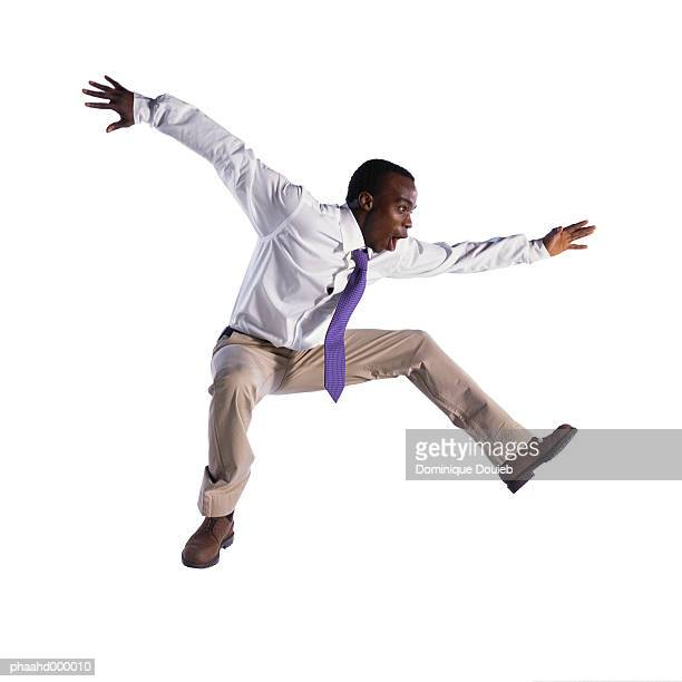 man jumping - legs spread open stock photos and pictures