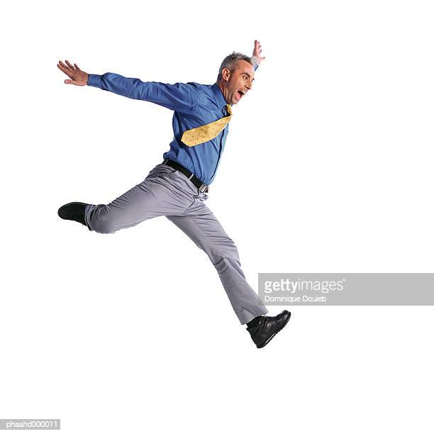 man jumping - human arm stock pictures, royalty-free photos & images
