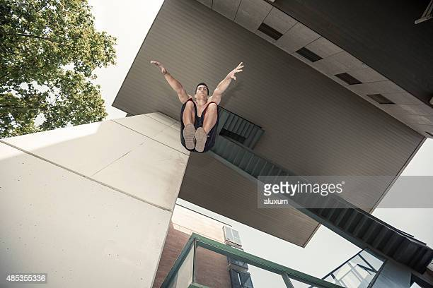 Man jumping practicing parkour
