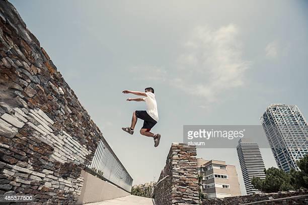 Man jumping practicing parkourin Barcelona Spain