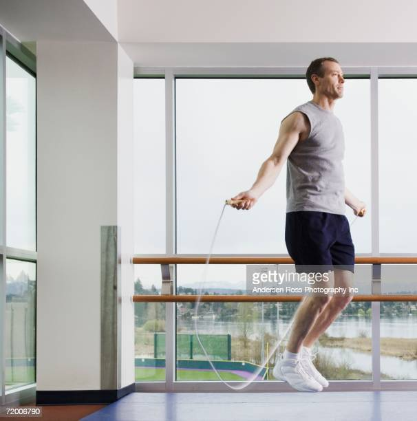 Man jumping rope indoors