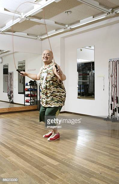 a man jumping rope - metabolic syndrome stock pictures, royalty-free photos & images
