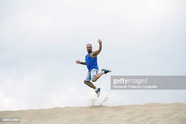 man jumping sand dunes, Maspalomas, Gran Canaria (Spain)