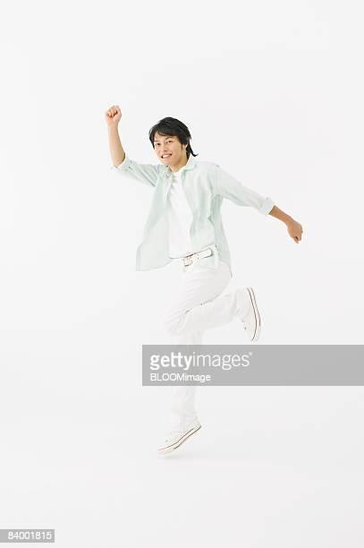 Man jumping, studio shot