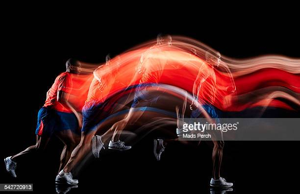 man jumping through air - motion stock pictures, royalty-free photos & images