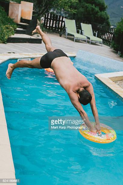 A man jumping to the pool