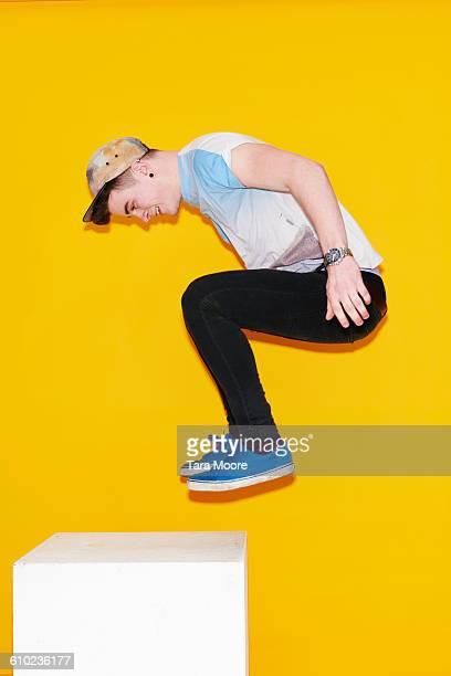 man jumping up on box