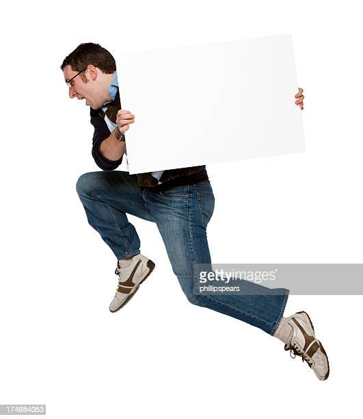 Man jumping with a blank sign
