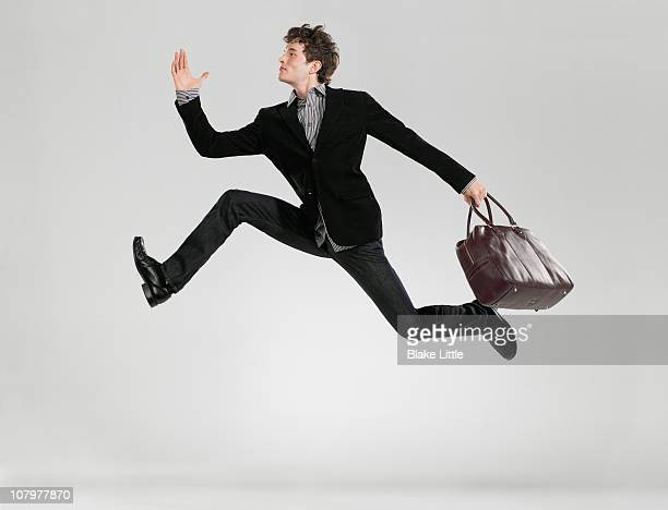 Man jumping with bag