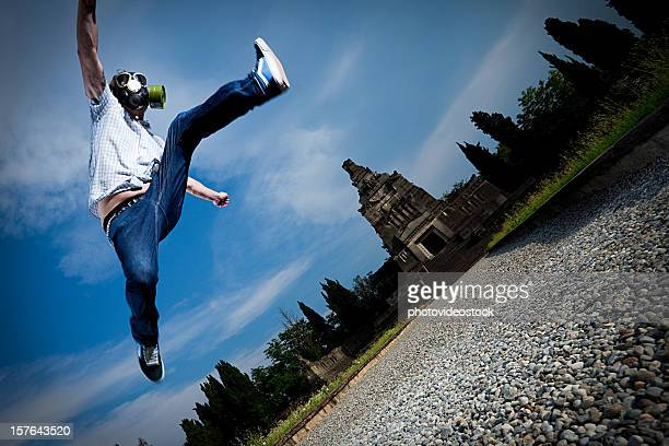 Man jumping with gas mask