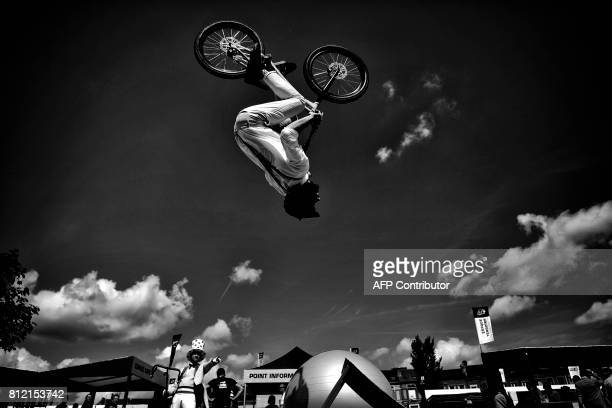 A man jumping with his bike performs prior to the start of the 2125 km third stage of the 104th edition of the Tour de France cycling race on July 3...