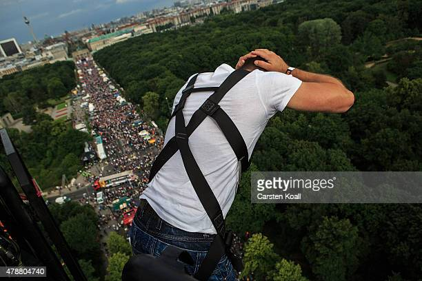 A man jumps for bungee jumping during the Cristopher Street Day parade on June 27 2015 in Berlin Germany Similar marches are taking place in various...