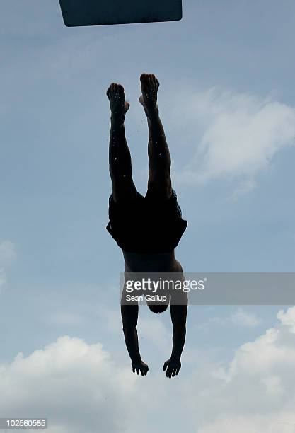 A man jumps from a diving board at a public pool on July 1 2010 in Kleinmachnow near Berlin Germany Temperatures are predicted to continue to climb...