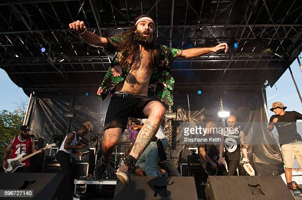 A man jumps off the stage while the punk band called Trash Talk performs during the annual Afropunk Music festival on August 27 2016 in New York City