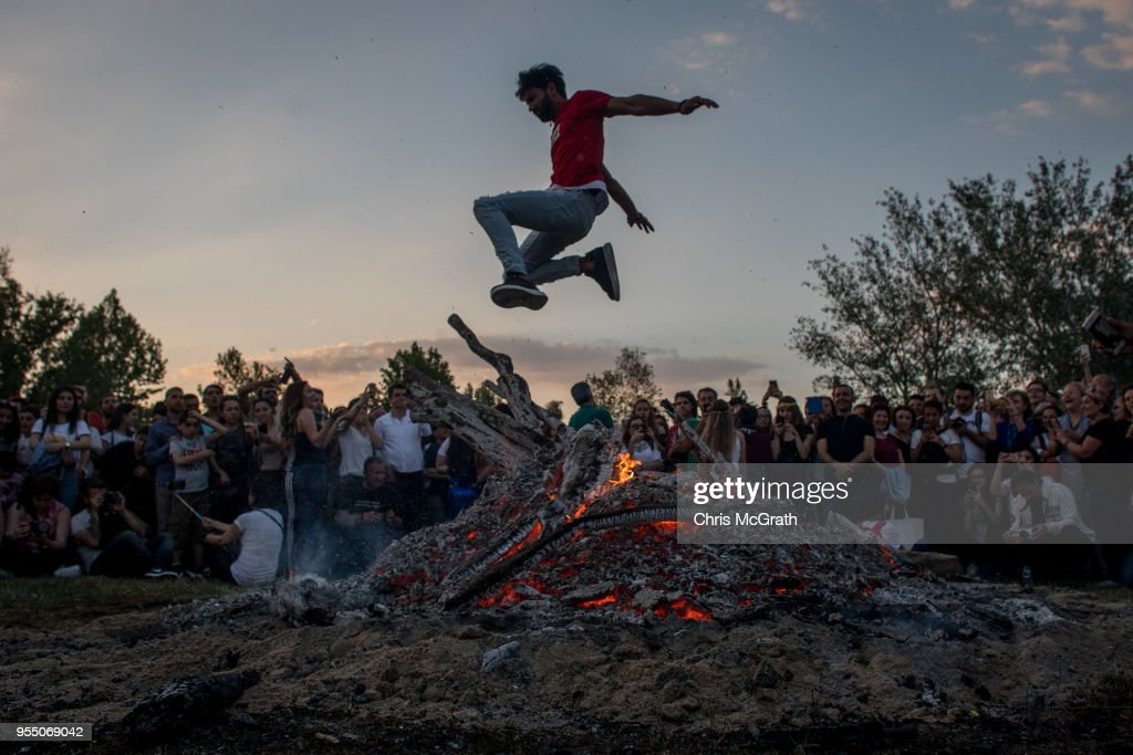 A man jumps over a large bonfire during the Kakava Festival on May 5, 2018 in Edirne, Turkey. The annual Kakava (Hõdõrellez) spring festival celebrates the coming of spring amongst the Roma community.