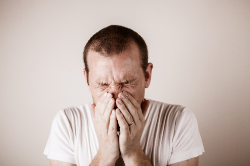 A man just before or after a sneeze - gettyimageskorea