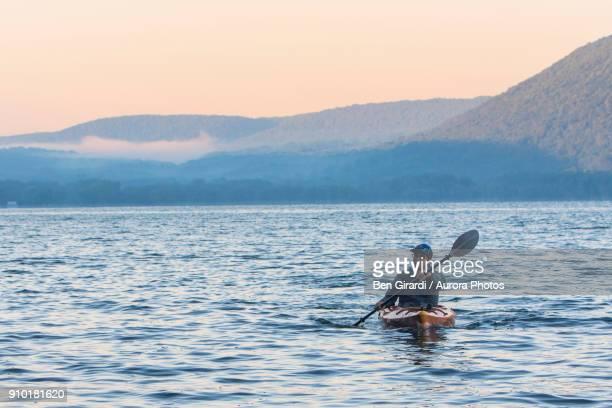 man kayaking at sunrise on skaneateles lake, skaneateles, new york state, usa - skaneateles lake stock pictures, royalty-free photos & images
