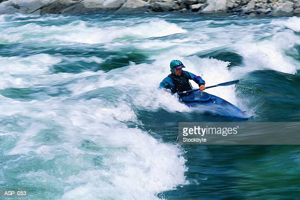 man kayaking in rapids - rapid stock pictures, royalty-free photos & images