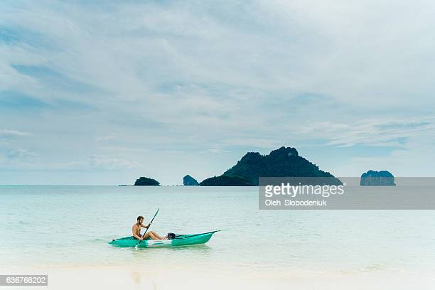 Man kayaking in the sea