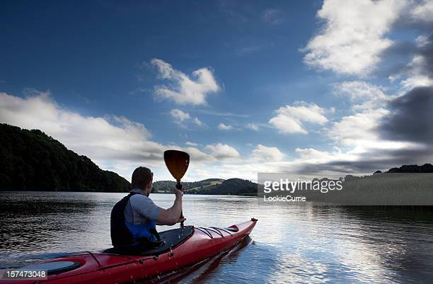 Man kayaking on a beautiful day