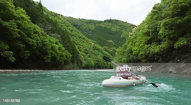 man kayaking on forest river - präfektur wakayama stock-fotos und bilder