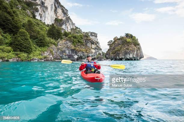 man kayaking on general carrera lake, puerto tranquilo, aysen region, chile, south america - sea kayaking stock pictures, royalty-free photos & images