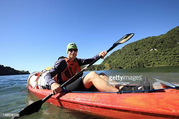 man kayaking on lake tarawera, rotorua - gerhard egger stock pictures, royalty-free photos & images