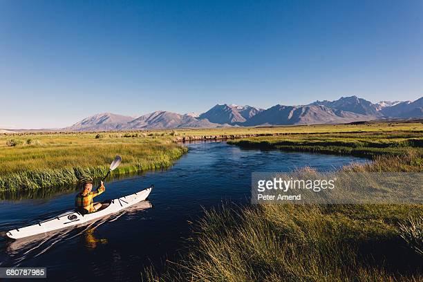 Man kayaking on river, Mammoth Lakes, California, USA