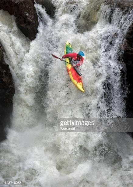 man kayaking on waterfall on river - kayak stock pictures, royalty-free photos & images