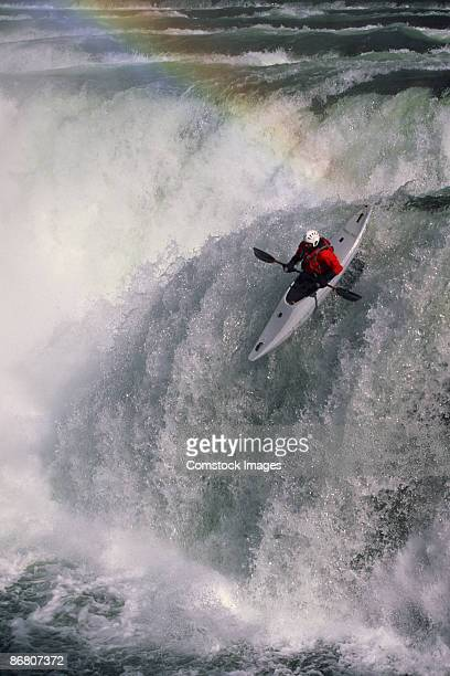 Man kayaking over Kootenai Falls