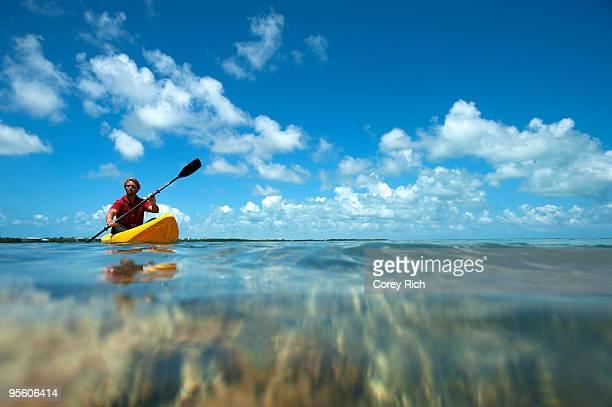 a man kayaks in florida. - kayak stock pictures, royalty-free photos & images