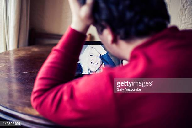 Man keeping intouch with his girlfriend online