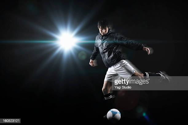 Man kicking a soccer ball