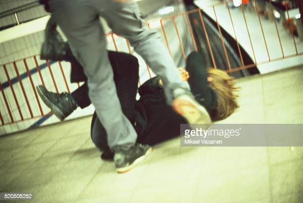 Man Kicking a Woman in Subway Station