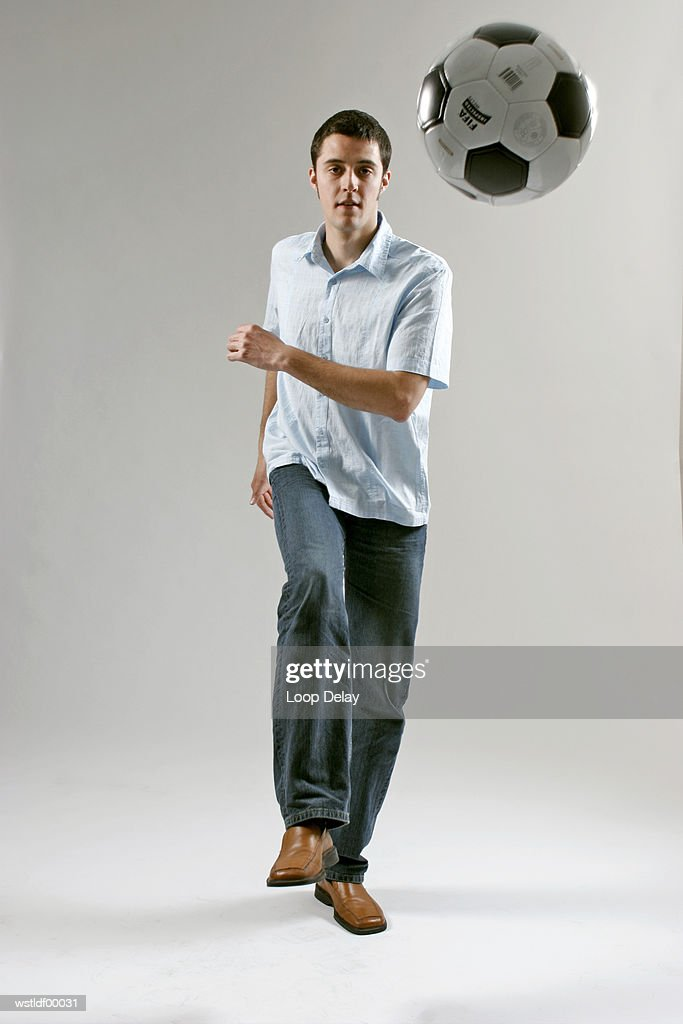 Man kicking the football : Stock Photo