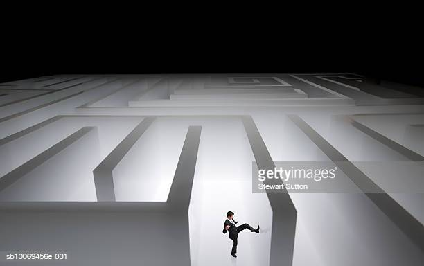 Man kicking wall of giant maze