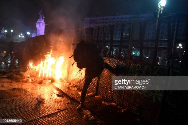 A man kicks a fence during protests outside the National Congress in Buenos Aires on August 9 after senators rejected the bill to legalize abortion...