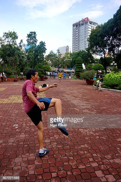 A man kicks a weighted shuttlecock towards his team mate Vietnams national sport known as Da Cau Also known as Jianzi in China a popular traditional...