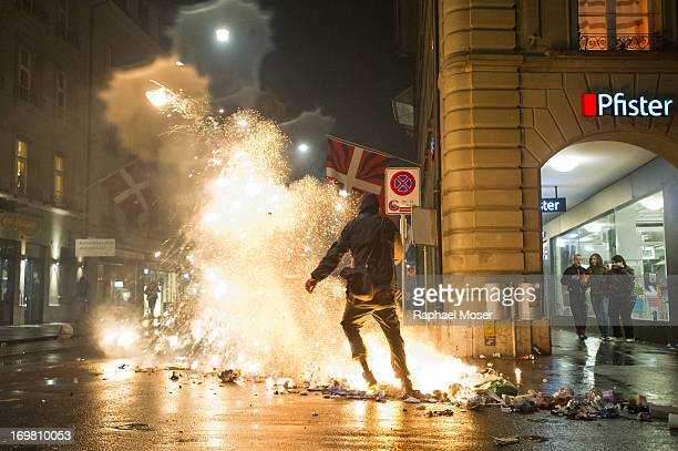 CONTENT] A man kicks burning waste in the center of Switzerland's capital Bern during the 3rd edition of 'Tanz Dich Frei' a politicallytinged dance...