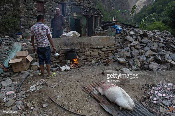 A man killed his goat in order to eat as they not usually practice that at this time on the Araniko Road near the Kobani Village Isolated Nepalese...