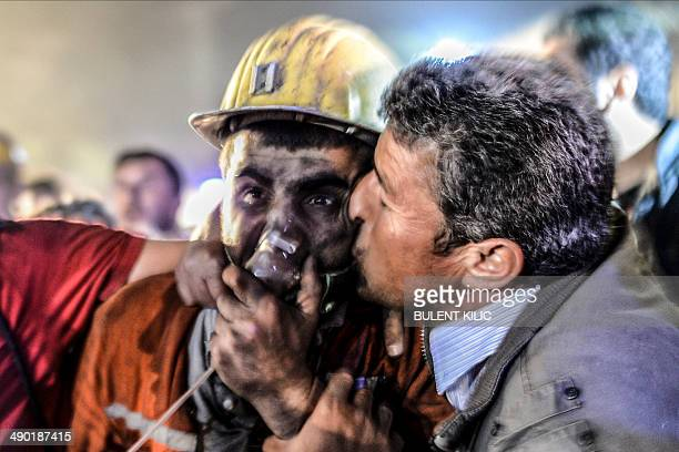 Man kisses his son, rescued of the mine, on May 13, 2014 after an explosion in a coal mine in Manisa. At least 157 miners were killed in collapsed...