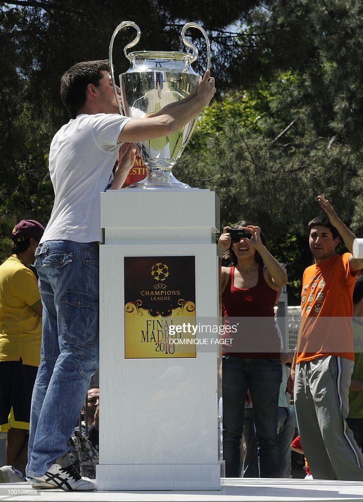 A man kisses the UEFA Champions League Cup on display at the Retiro Park in Madrid on May 21, 2010 ahead of the UEFA Champions League final. Inter Milan will face Bayern Munich for the UEFA Champions League final match to be played at the Santiago Bernabeu Stadium in Madrid on May 22, 2010.