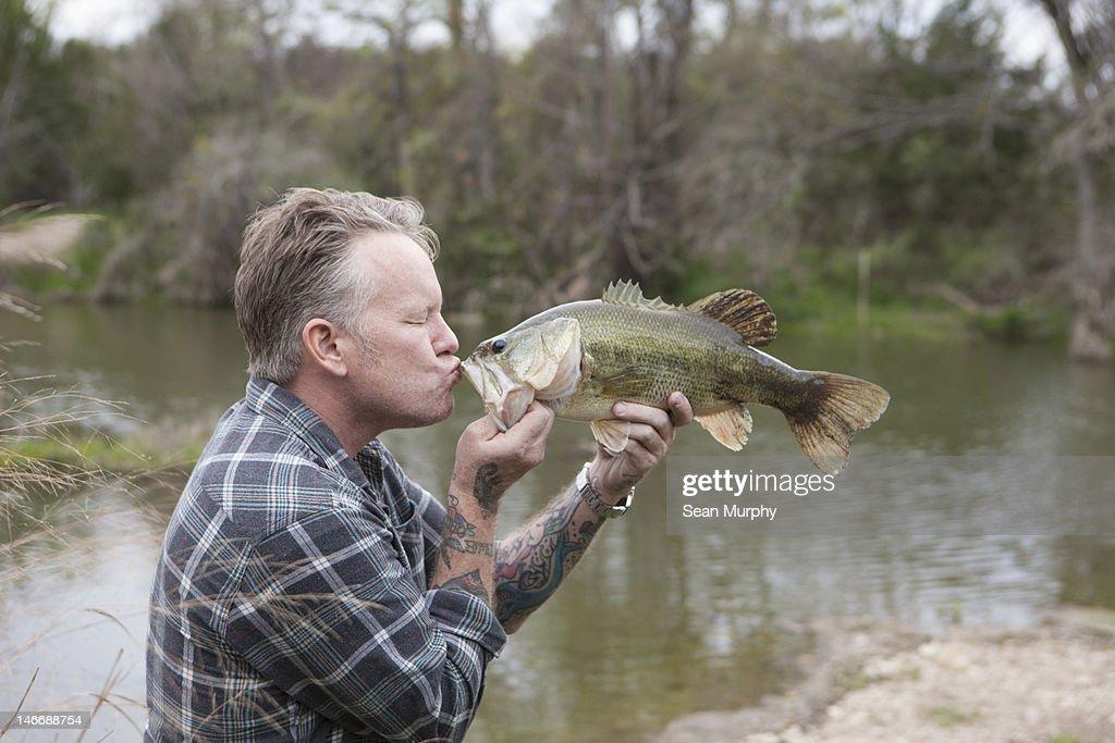 Man Kissing a Fish : Stock Photo