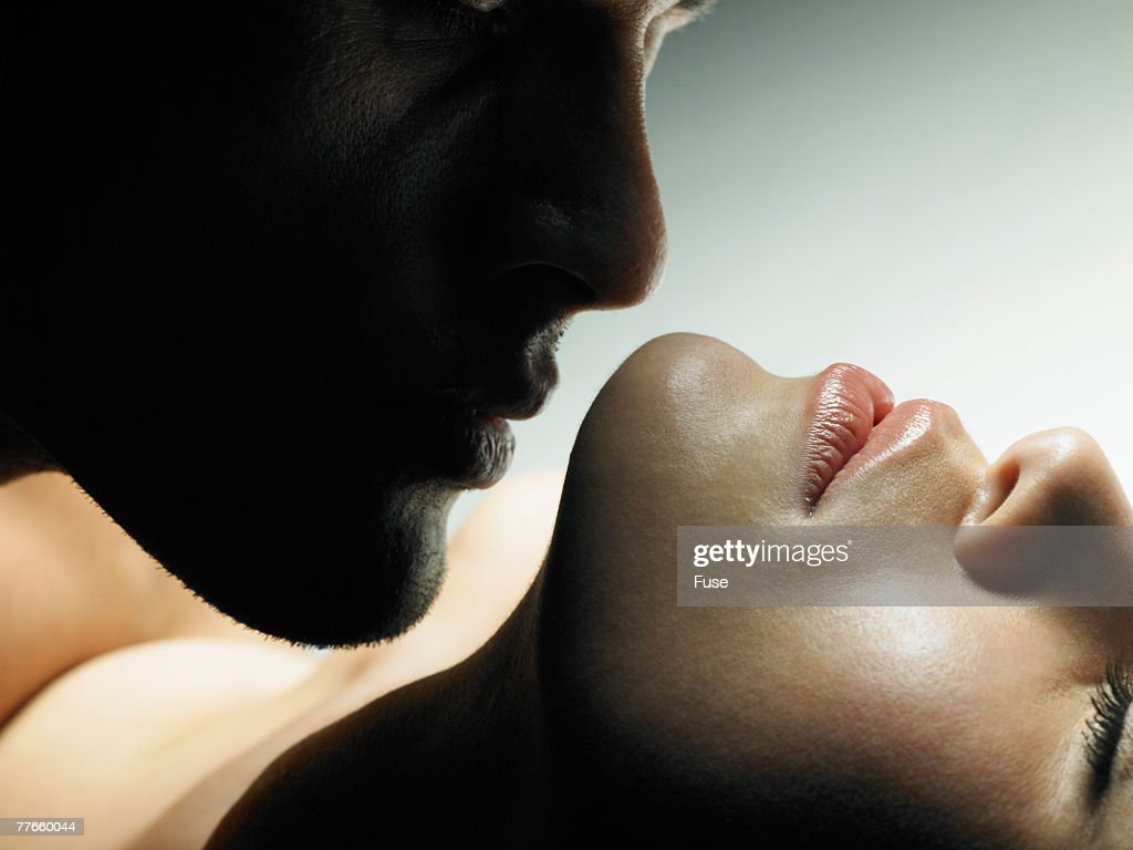 Man Kissing a Woman : Stock Photo