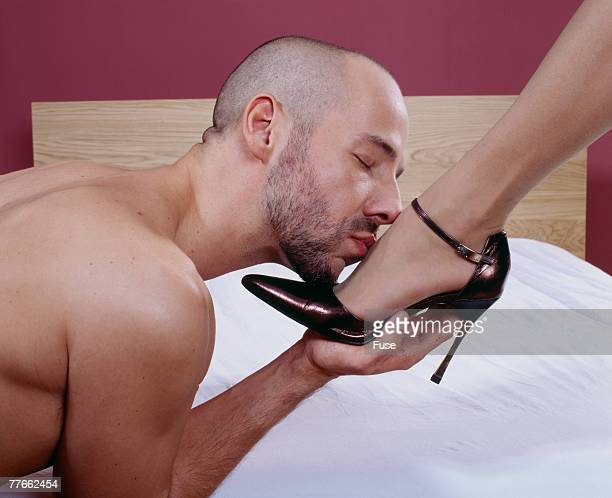 man kissing a womans foot - fetish wear stock photos and pictures